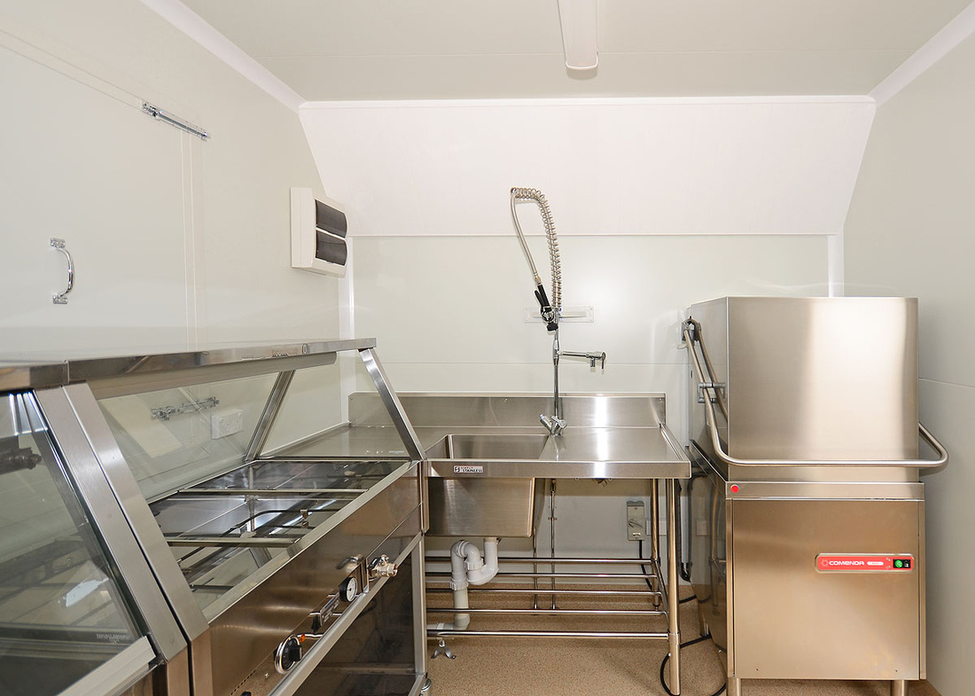 stainless appliances in a mobile kitchen built and manufactured by King Caravans Maryborough Queensland
